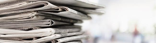Artikel-Tipp Cross-Selling Potentiale realisieren Zeitungsstapel
